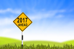2017, Road sign in the grass field to new year and blue sky, can Royalty Free Stock Image