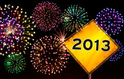 Road sign Happy New Year 2013. Fireworks sparks with happy New year 2013 text in yellow road sign Royalty Free Stock Image