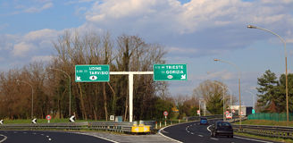 Road Sign in the highway junction to go to Austria or Slovenia Stock Photography