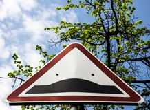 Road sign hillock. Is an elevation warning sign royalty free stock photo