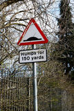 Road sign for humps and bumps on the surface. Road sign for humps and bumps on the surface man made stock image