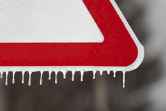 Road sign with icicles Royalty Free Stock Photography