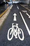 Road sign on a typical cycle path in UK. Road sign illustrating a direction of travel on a cycle path, typical to cities in UK Royalty Free Stock Images