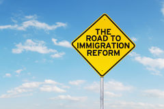Road sign with immigration reform word Royalty Free Stock Photo