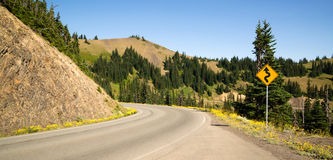 Road Sign Indicates Curves Ahead Mountain Landscape Stock Photos