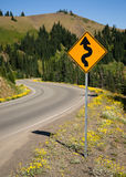 Road Sign Indicates Curves Ahead Mountain Landscape Royalty Free Stock Photography