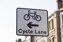 A road sign indicating the availability and position of a cycle. Lane in Warrington May 2018 Royalty Free Stock Photography
