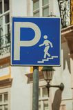 Road sign indicating the ladder for the parking under the street. Close-up of square blue road sign indicating the access ladder for the parking under the street royalty free stock images