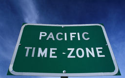 Road sign indicating Pacific time zone Stock Images