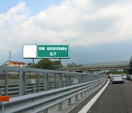 road sign indicating with text FINE AUTOSTRADA which means the e Stock Images