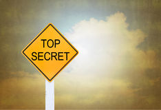 Road sign indicating Top Secret on blurred vintage background Stock Image
