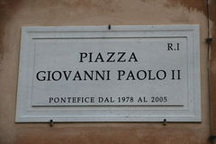 Road sign with an indication of the Piazza Giovanni Paolo II Pop. Marble road sign with an indication of the Giovanni Paolo II Pope in Rome Italy Stock Photo