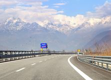 Road sign with indication to go lake Como in Italy. Traffic on hihgway in the Italian Alps Stock Images