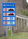 Road sign with the indications of speed limits on the Italian bo. Big Road sign with the indications of speed limits on the Italian border stock photos