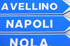 Road sign with the inscription: Avellino, Naples and Nola Stock Images