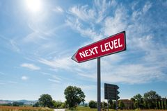 Road sign with the inscription Next Level.  Royalty Free Stock Photos