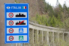 Road sign at the Italian border with indications of the speed li. Mits to be observed in Italy stock image