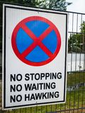 Road sign in Lagos, Nigeria; No stopping, no waiting, no hawking. A road sign in Lagos, Nigeria, warning against stopping, waiting, or hawking stock images