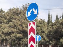 Road sign left or right turn driving royalty free stock images
