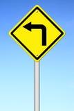 Road Sign - Left Turn Warning Royalty Free Stock Image