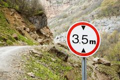Road sign limiting altitude. On a mountain road Royalty Free Stock Images