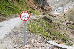 Road sign limiting altitude. On a mountain road Stock Photo