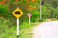 Road sign beside the main road go to the mountain Royalty Free Stock Image