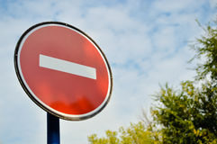 Road sign meaning 'stop' with white brick in Stock Images
