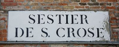 Road sign that means Saint Crux District in Italian Language in. Venice Italy. The name Sestier means neigborhood Stock Images