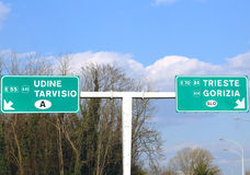 Road Sign in the motorway junction in Northen Italy with crossro Royalty Free Stock Photo