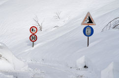 Road sign on a mountain road Royalty Free Stock Photo