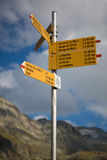 Road sign in the mountains of Valais in Switserland. Road sign in the mountains of the canton of Valais, various signs with directions and distances between Stock Photos