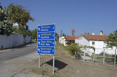 Road sign with names of settlements in the English and Greek languages royalty free stock photo