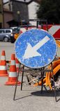 Road sign near excavation for the laying of telecommunications i Royalty Free Stock Photography