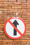 Road sign no go ahead the way on red brick wall. Stock Image