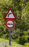 Road sign. No passing road and curve sign in Jijel, Algeria Royalty Free Stock Photography