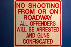 Road sign: No shooting from or on roadway. All offenders will be arrested and guns confiscated. Road sign: No shooting from or on roadway. All offenders will be Royalty Free Stock Photos