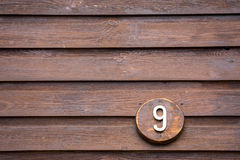 Free Road Sign On A House Reading The Number Nine Made Out Of Wood Stock Photo - 96856210