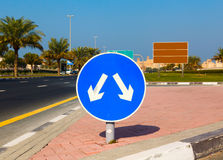 Road sign with opposite arrows Stock Photos