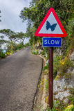 Road sign ordering slowing. UK Royalty Free Stock Images
