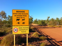 Road sign in outback Australia Beware caution Royalty Free Stock Photography