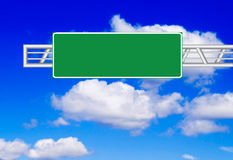 Road sign. Over blue sky Stock Photos