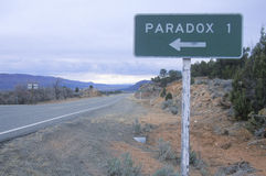 A road sign for Paradox Stock Photos
