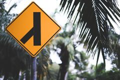 Road sign in the park. Lanes merging left Stock Photography