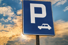 Road sign Parking area or Rest stop. Against the evening sky Stock Images