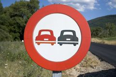 Road sign for passing in Pyrenees Mountains, Province of Huesca, Spain Royalty Free Stock Image