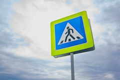 Road sign of a pedestrian crossing close up Royalty Free Stock Photo