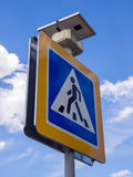 Road sign of a pedestrian crossing equipped with a solar battery Royalty Free Stock Image