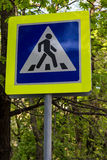 Road sign pedestrian crossing in foliage Stock Photos