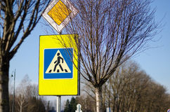 Road sign pedestrian crossing and intersection Royalty Free Stock Photo